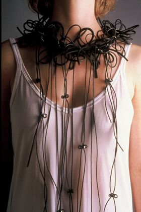Rain Necklace by Lonna Keller made with black neoprene rubber, fine silver and hematite.