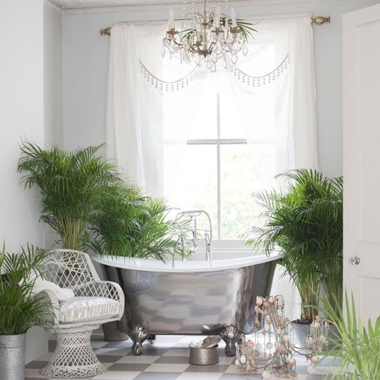 A luxurious modern, grey bathroom, with pops of colour from plants. Via housetohome.co.uk