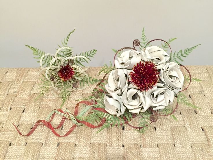 Bride waterfall bouquet in Ivory roses and large Pohutukawa flower with fern & bridesmaids single Pohutukawa posy. www.flaxation.co.nz