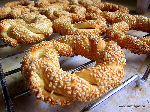 Greek Koulouria - Braided bread twists with sesame seeds. Soft and chewy on the inside, crusty on the outside. Roll them up tighter for a great sandwich roll.