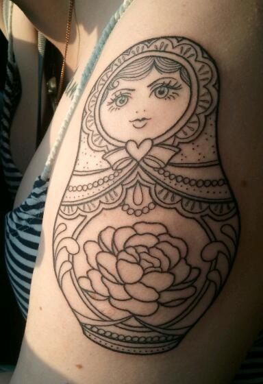Love the shape of this babushka tattoo