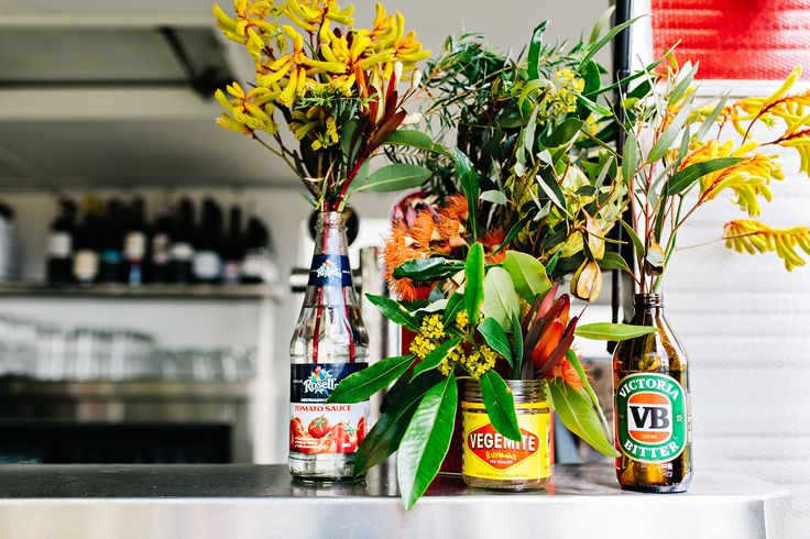 Use Australian food containers as decoration for your Australia Day party this year.  Add native flowers to Vegemite, Rosella and VB bottles.