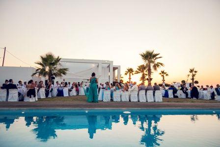 After dinner speeches beside the impressive swimming pool at villa wedding in Crete. Moments www.weddingincrete.com