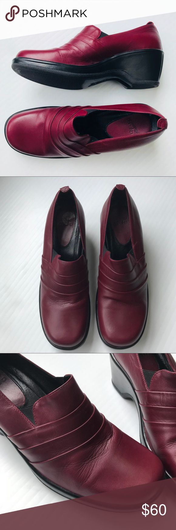 NWOT Danskos Cherry Red Loafers Never worn except to try on! This is Dansko's newer model that is less of a clog and more of a loafer. Still gives you that amazing ergonomic design that will envelope your feet in pure comfort. Dark cherry red color with a mary jane ribbing across the top. No scuffs, just the slight creases across the front toes from being tried on. Size 41 UK or 11 US. I am a size 10 and can wear these easily too. Dansko Shoes Flats & Loafers