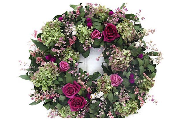 """18"""" Pink Roses & Larkspur Wreath Hydrangeas and roses, welcome harbingers of spring, add a lovely, feminine touch to a door or wall. The lush wreath also features pink larkspur, amaranth, and fragrant oregano.  From The Garden specializes in beautiful, modern designs of dried and preserved floral wreaths and arrangements.  Made of: salal, freeze-dried roses, pee gee hydrangea, larkspur, globe amaranth, ammobium, oregano."""
