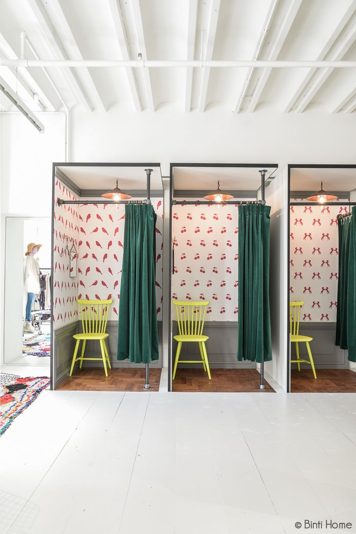 These adorable dressing rooms in an Amsterdam boutique make us want to wallpaper the insides of all our closets in cute prints. #DIY