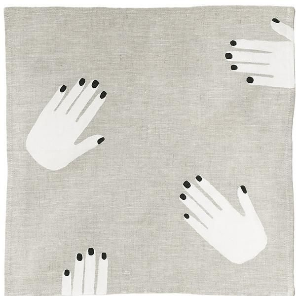 oatmeal grey linen napkin printed with white hands with black nails