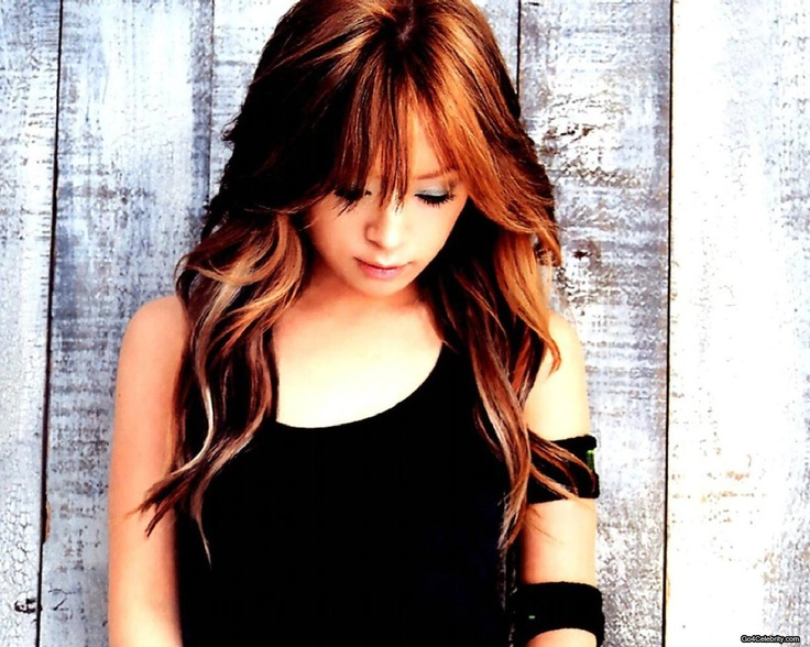 I've always loved this color and cut.  Warm reddish brown with caramel highlights, and wispy bangs.   Ayumi Hamasaki