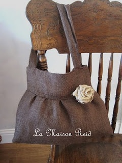 Burlap purse with contrasting material inside and fabric rose - not a pattern, but will try to come up with one.