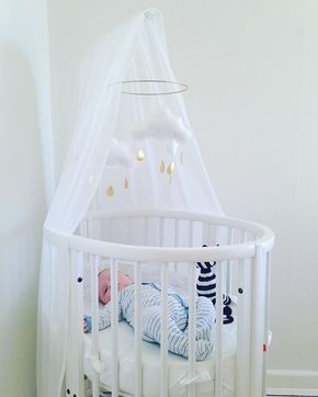 Our Stokke Sleepi mini crib's unique oval shape creates a nest for your baby Learn more about this 4-in-one bed. credit: @itismie