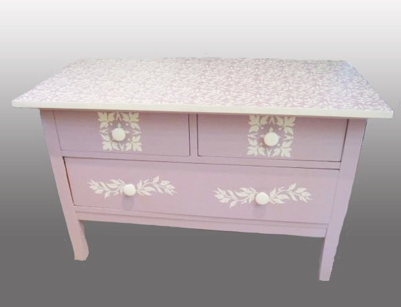 Short dresser, painted with Chalk Paint® in Henrietta, and old white stenciled top and front. (by Rachel Gingold, Artistic Home Studio & Boutique)