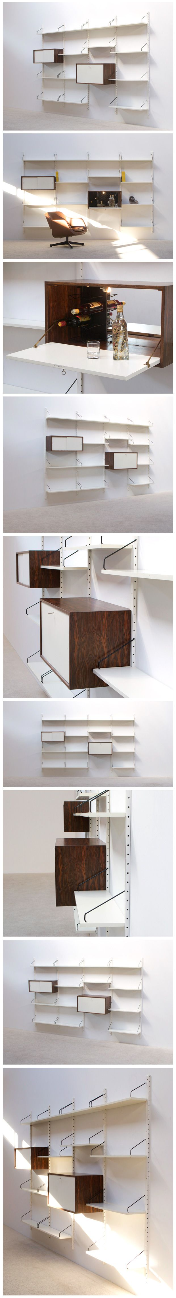 Danish modern off white floating wall unit Designed by Poul Cadovius for Royal System. Multiple shelves (13) and 2 Wenge compartments. 1 compartment with white gliding doors, the other compartment with illuminated mirror and bar integrated for refreshments.