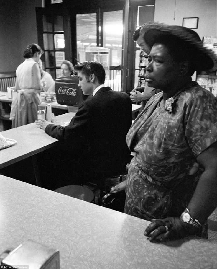 """historicaltimes: """"At a segregated lunch counter in a Chattanooga, Tennessee, Elvis Presley waits for his bacon and eggs while a woman waits for her sandwich, she is not permitted to sit. 1956...."""