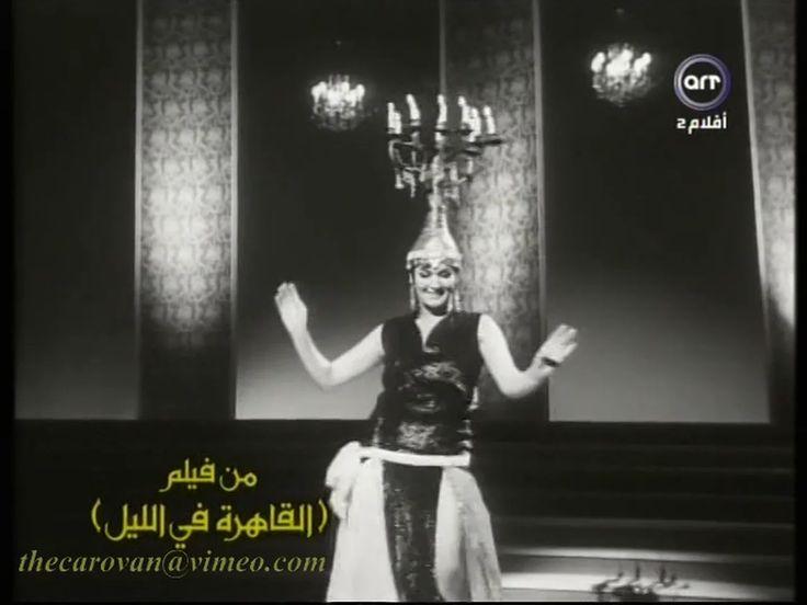 This is Egyptian dancer Nagwa Fouad performing with a shamadan (candelabra) in a scene from the 1963 film 'Al Qahira fel Lel' (Cairo by Night النادر…