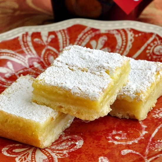 Super Easy Lemon Bars - the easiest lemon bar recipe I've ever tried actually turned out to be the vest I've ever tasted too! A rich buttery shortbread bottom and a light creamy, tangy lemon custard top. Lemon lovers may have to be physically restrained from polishing off an entire batch! Share this one with lemon fans you know; they will thank you for it.