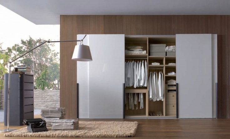 Decoration: White Wardrobe As Well As Woodgrain Floor And Walls Also Unique White Standing Lamp With Stainless Steel Frame Also Black Small Cabinet With Drawer Plus Creame Fur Rugs Design Ideas: Beautify Your Room with Modern Minimalist Wardrobe Designs