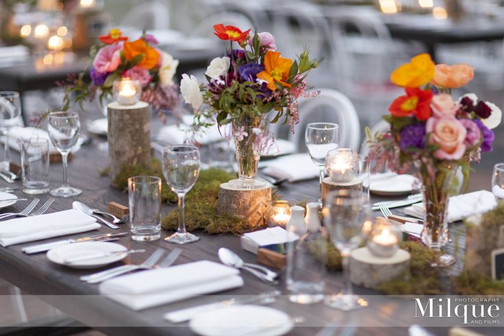 A whimsy woodland wedding of moss green and cascading florals from chandeliers in a bush setting