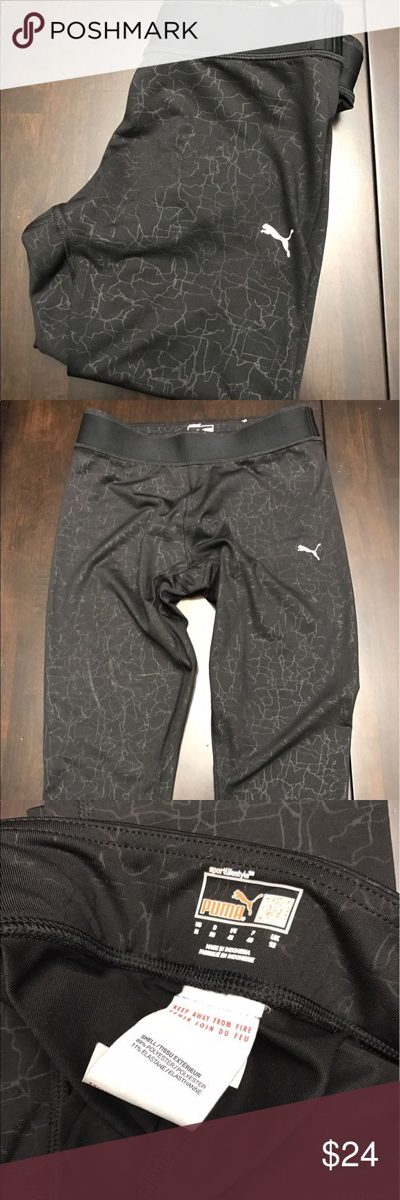 Puma Sport Workout Capri Leggings Puma Sport/Lifestyle Capris.  These capris are perfect for a working out or just wearing around the house.  The strong elastic band keeps them up and in place.  They are black with a crackle print.  Size Medium.  Capri Style Legging. Puma Pants Capris