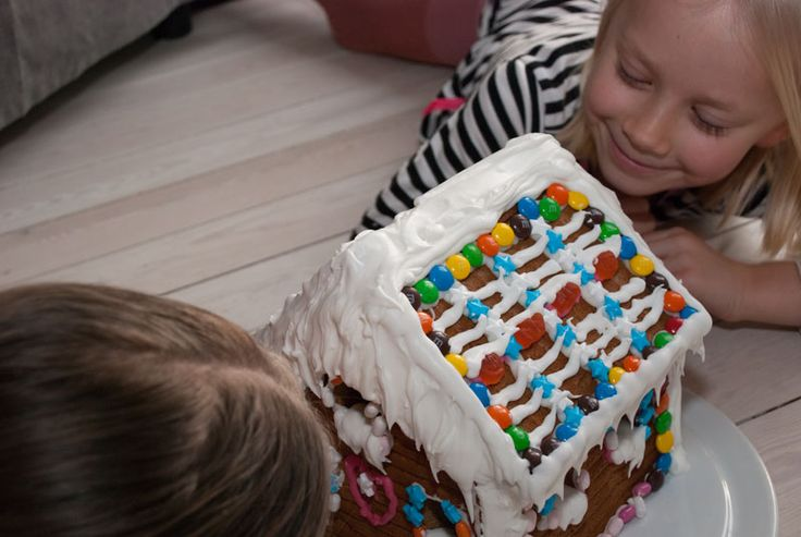 Who says you cannot play with a gingerbread house?  #Christmas #gingerbreadhouse