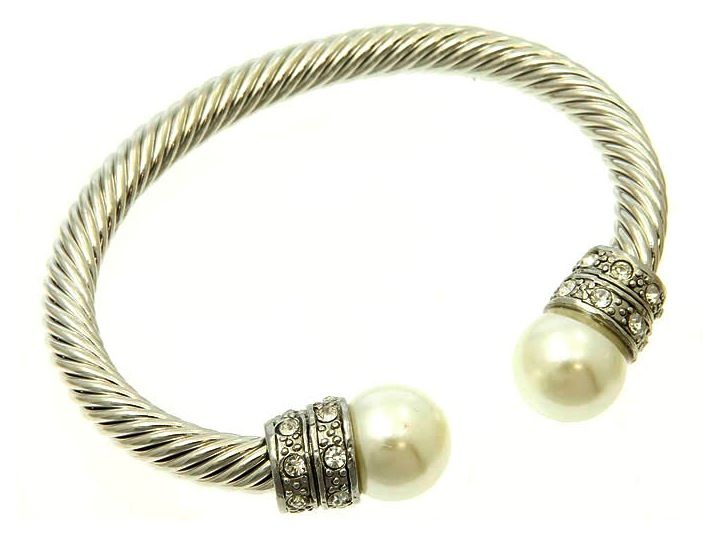 Gorgeous chunky torque bangle made with rhodium, dotted with crystals and finished with lustrous pearls. £28.00