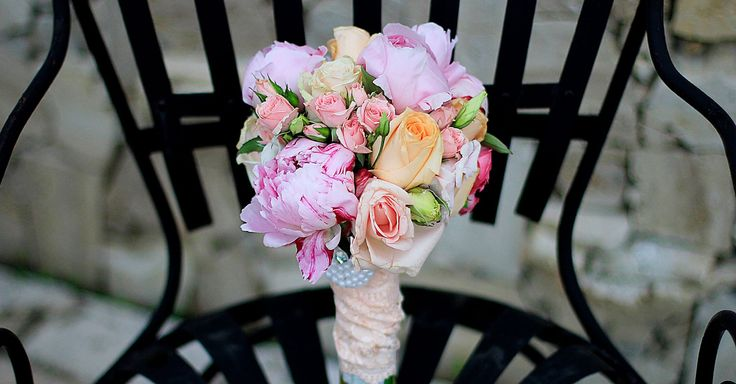 Blooming pink, peach and rose bridal bouquet.