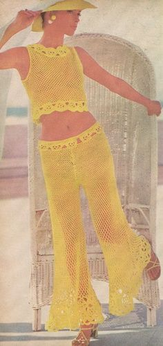 Vintage fashion, 70s yellow crocheted pant suit crop top color photo model magazine print ad