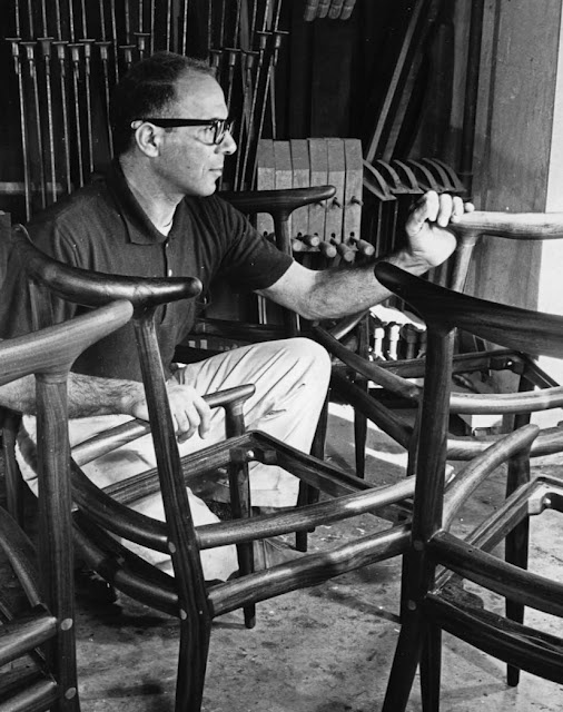 Sam Maloof in his workshop with horn-back chairs, c. 1960.