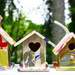 Painting wooden birdhouses is a great kid friendly art project for spring.