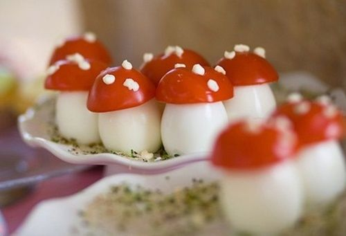 Mushrooms made with boiled eggs & scooped out cherry tomatoes dotted with cream cheese........ ADORABLE