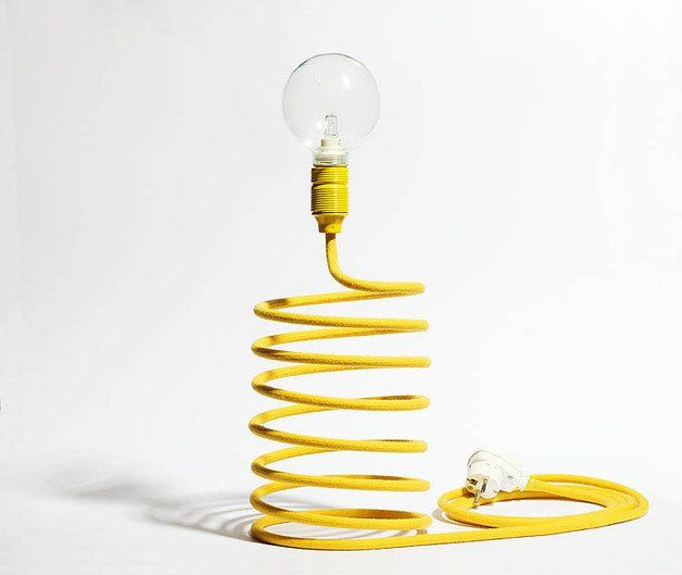 "Light ""spring"". Perfect for a coffee table or desk. Cable weave in yellow colour - cotton. Yellow metal fixtures. Switch with plug socket white. The lamp is delivered without bulb!"