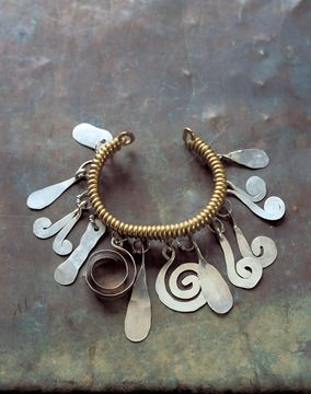 "Alexander Calder, Bracelet, c. 1930 Brass, silver, and steel wire 2 3/4"" x 2 3/4"" x 2"""