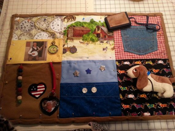 these fidget quilts are made from your loved ones personal and favorite items. also included can be items of each family member.   the quilts