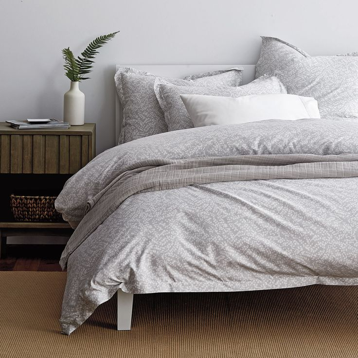 Gray sheets & bedding set crafted from luxurious 400-thread count cotton sateen. Designed in abstract botanicals.