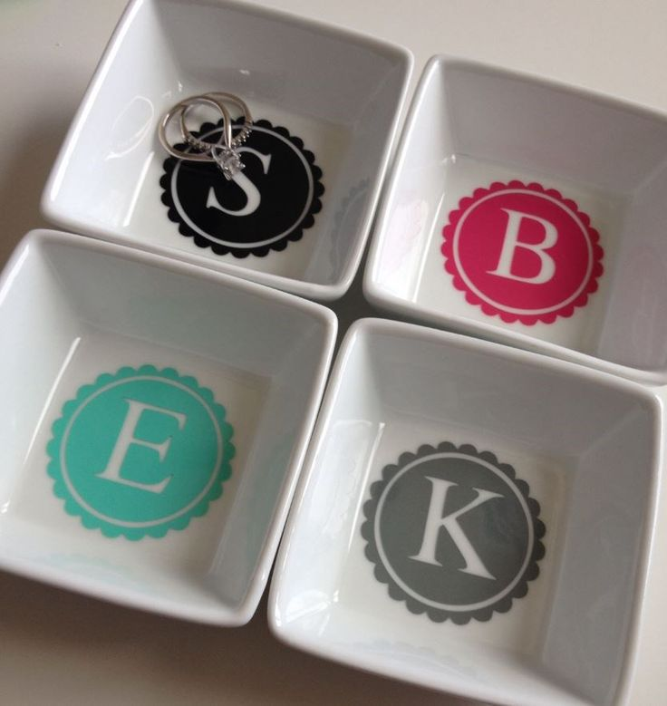 "These super cute, personalized ring dishes are perfect for by the sink, on your nightstand or anywhere else you may take off your rings or earrings! Each 3"" square ceramic dish includes your choice of personalization with lots of colors to choose from! Don't forget one for the bride-to-be, teacher, coach, co-worker or that special someone's stocking.Personalization options: Single Script InitialMonogram Script Initials (first, LAST, middle)Doily LetterMrs.Mr.Dia..."