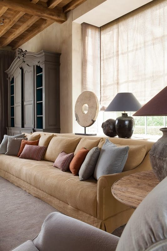 """""""The rough linen texture of the seat upholstery and window treatment in combination with beautiful chosen decorative accessories and objets d'art, emphasises the rustic look of the room.""""   ...Belgian Pearls"""