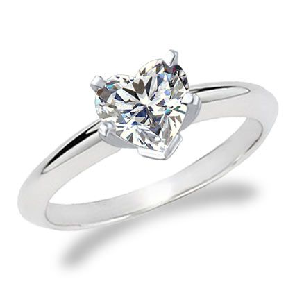 Heart shaped diamond ring. I'm not one to fantasize about rings but I really like heart-cut.