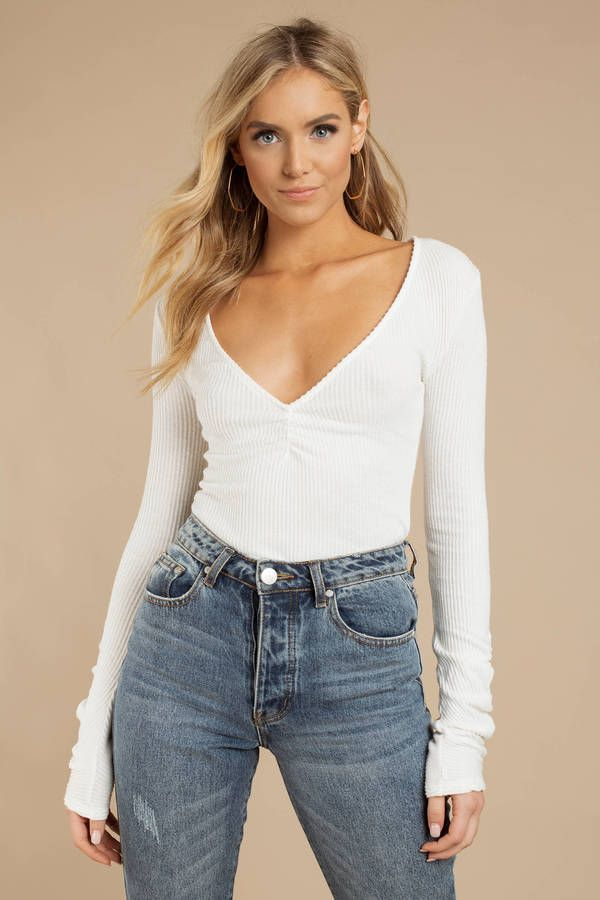 6858bf8578 Layer it up this season with Free People's Cozy Up With Me Ivory Bodysuit.  This