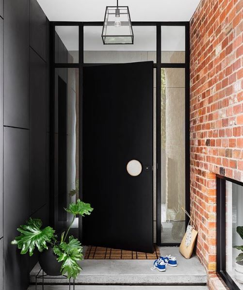 The side door of this heritage property real packs a punch, against the red brickwork and black aluminium framework. ✔️ • Door painted in Haymes 'Intrigue'. Photos by @gemmola by @buildhercollective Styling by - @emma_omeara
