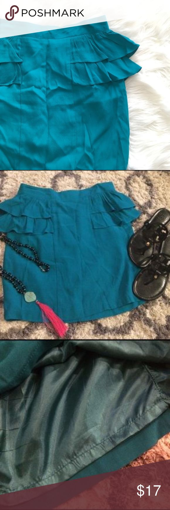 Teal Mini Skirt Ruffles Teal mini skirt. Fully lined. Ruffles in side and back. Zipper/clasp closure. Polyester/rayon. Approximately 28 inch waist. 16 inch from waist to bottom hem. Accessories not included from picture. Super cute and great for a night out! Forever 21 Skirts Mini