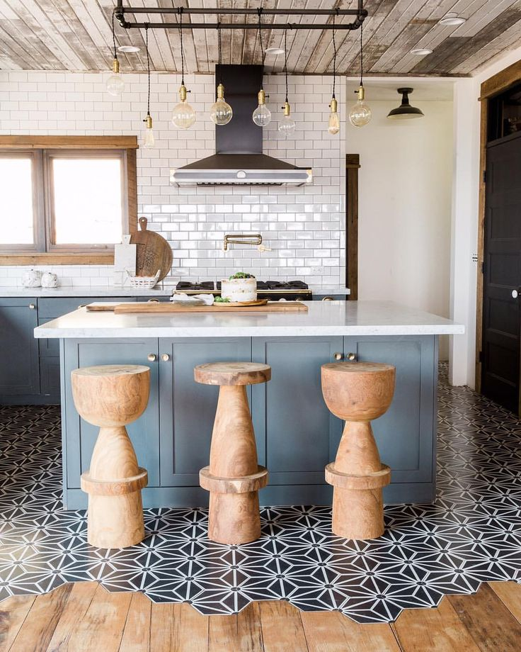 We cant help but swoon over this kitchen just look at the floor detail we are inspired by that real wood paneling on the ceiling anyone up to do a