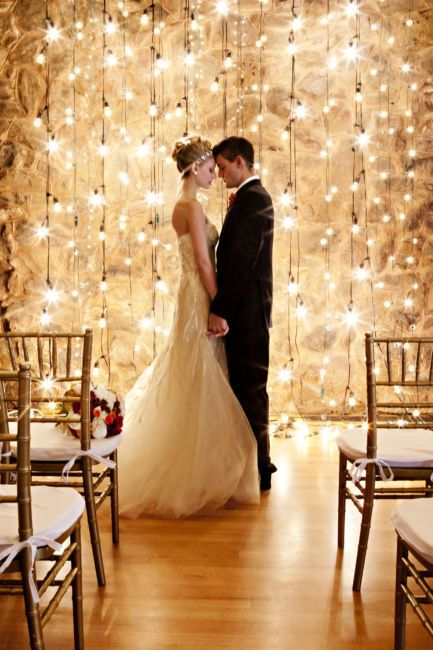 Best Wedding Ideas 10 Unique Statement Walls for Your Wedding Decor | Dress up your wedding with twinkly lights for a dreamy and romantic look. Hanging lights create an ambiance like no other, and they're not just for Christmas! Use them during your ceremony and reception to leave your guests feeling impressed.