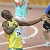 2012 London Olympics - Bolt v. Marathoners  Usain is faster but not as impressive, Amby Burfoot writes.