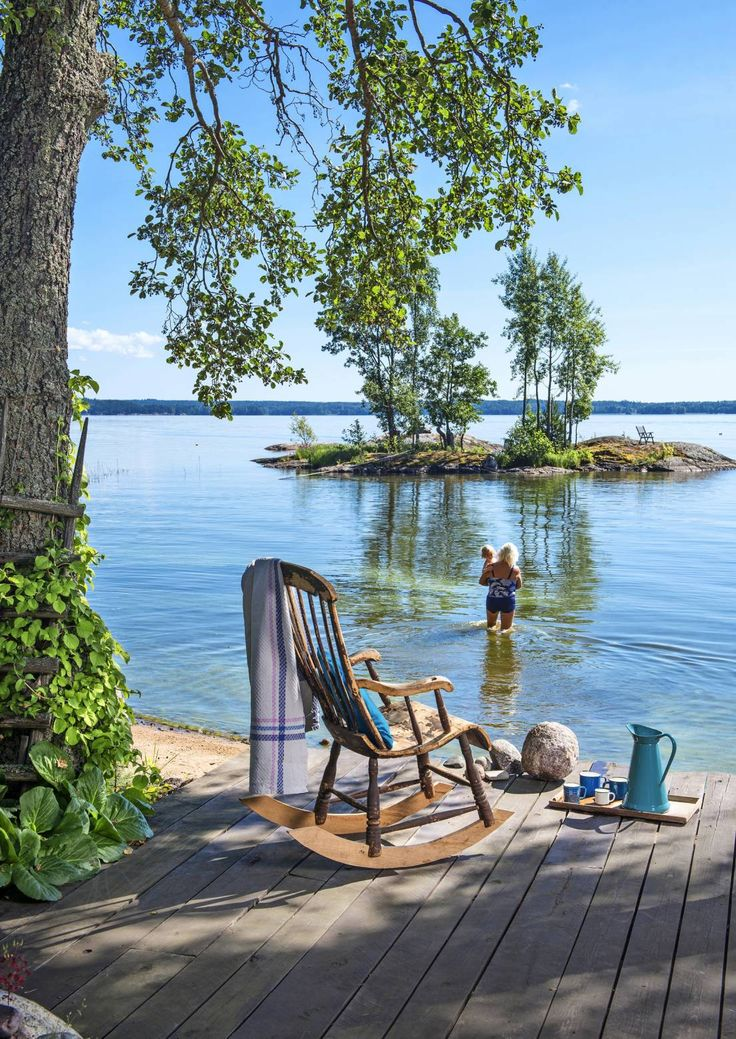 a lake , a rocking chair and coffee in a can all you need to have in summer wake up ritual for summer