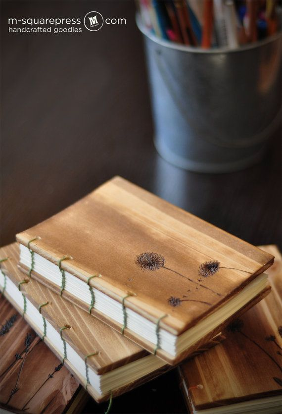 This is a small light-weight beautiful cedar wooden cover with dandelion flowers burned on the front cover. There are cream color text paper inside