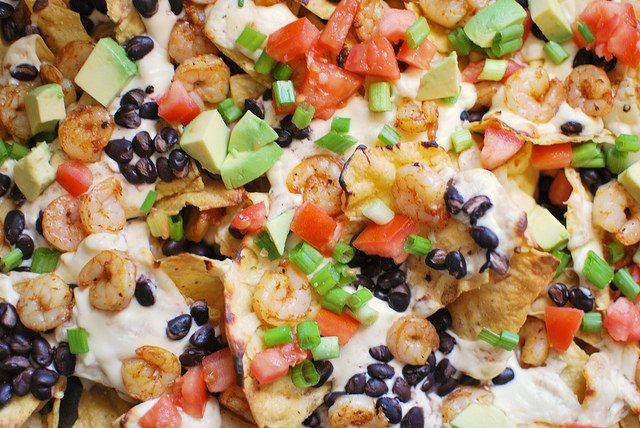 Spicy Shrimp Nachos topped with Pepperjack #cheese sauce! Talk about comfort food!