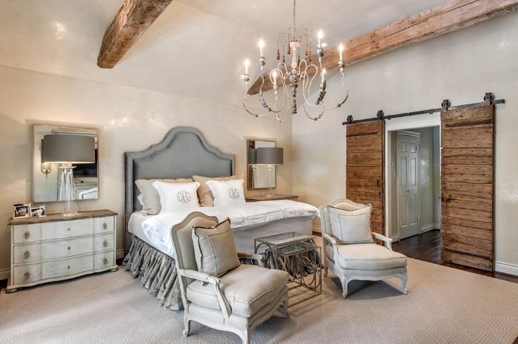 love the lamps, chest of drawers on either side of bed and chairs at the end of the bed