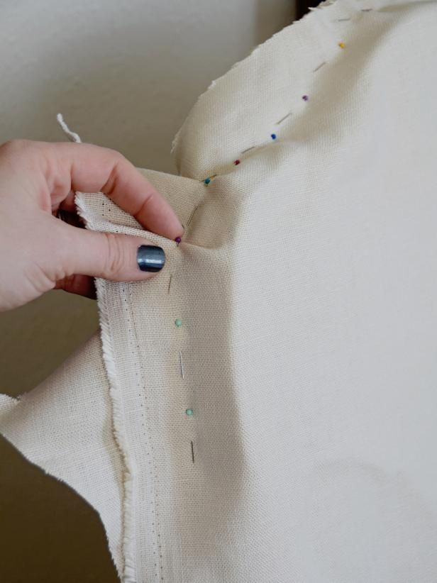 A slipcover is assembled or  quot pin fitted quot  inside out  If using a fabric with a clear right side  make sure right side is facing in toward the chair  Starting from the top of the chair back  pin front and back pieces together  Pin along the back line of the chair  It  39 s best to pin the entire top  then alternate pinning a few inches down each side to prevent gaping in the back