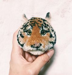 Look At These Amazing Animal Pom-Poms   Top Crochet Pattern Blog. This is really stunning!