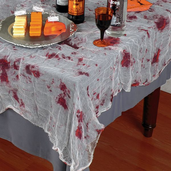 Bloody gauze table cover halloween pinterest for Table zombies