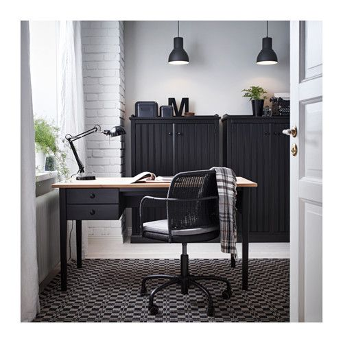 home office design with arkelstorp desk and sideboard in black and wood and feodor swivel chair in black